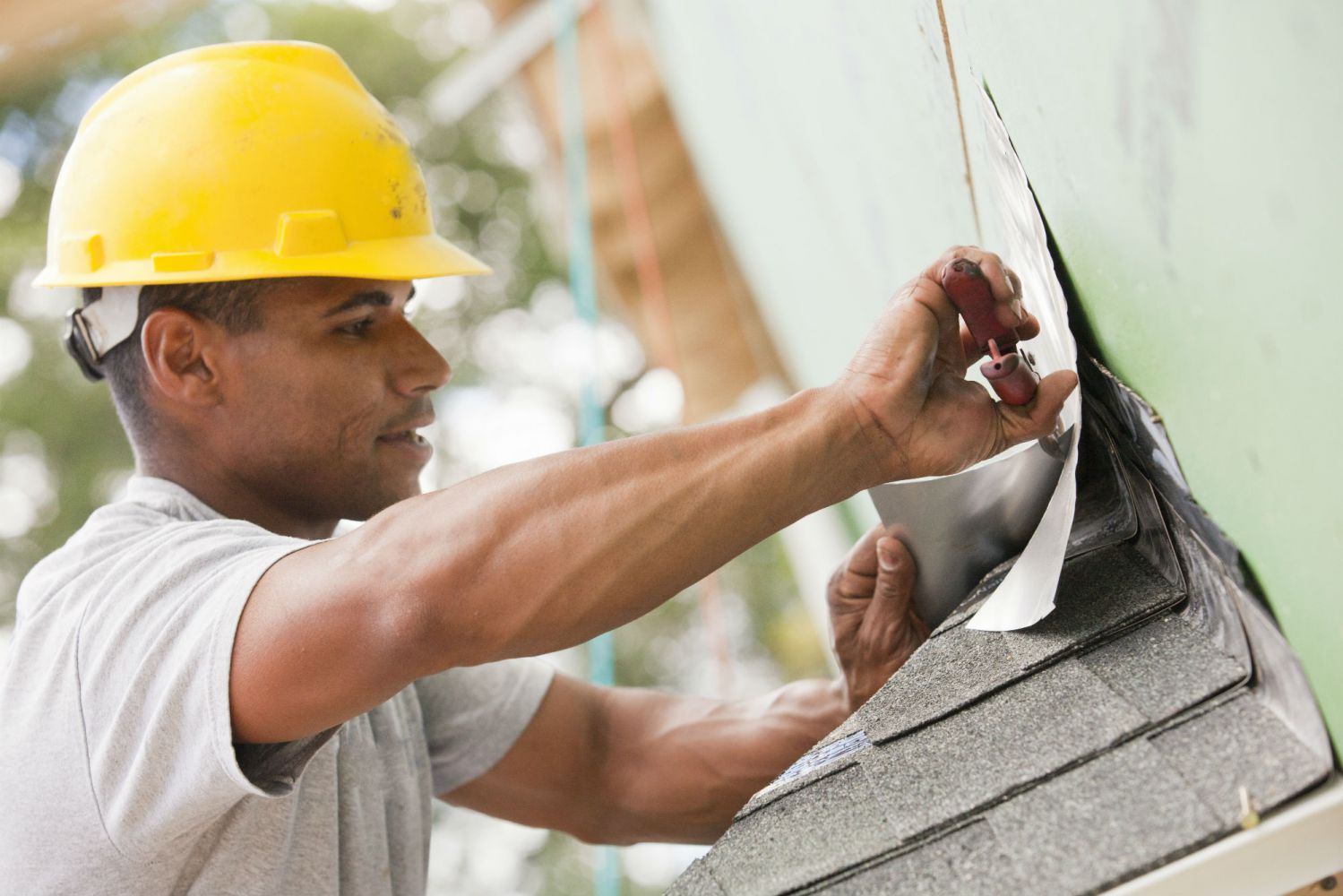 roofing contractors installing shingles in Crescent Spring, KY