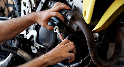 Expert repairing a motorcycle in Leeds, AL