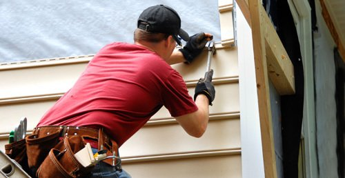 Professional providing siding installation in Trafford, PA