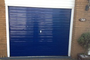 A fixed blue garage door