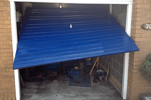 A broken blue garage door