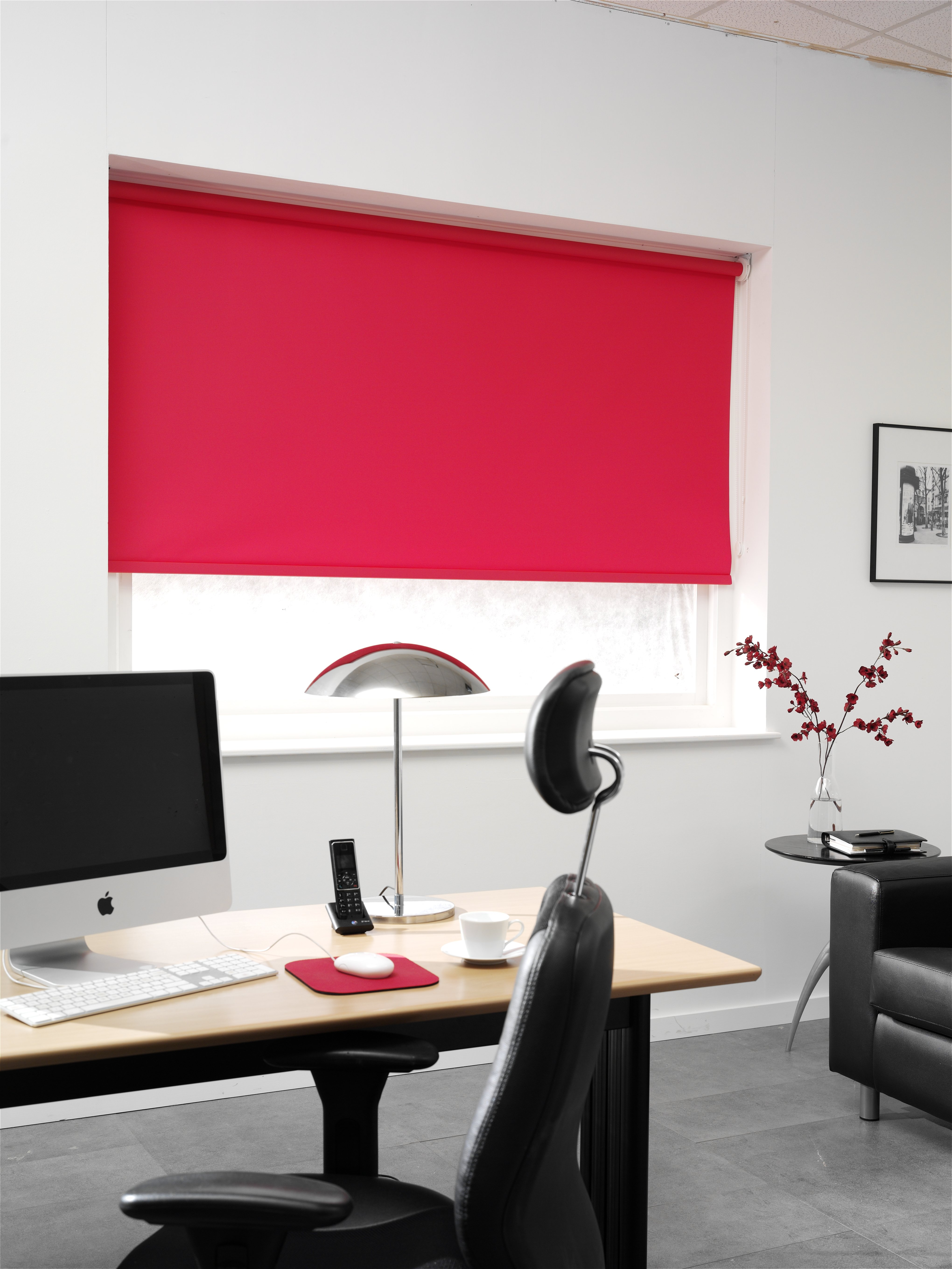 A bright red roller blind
