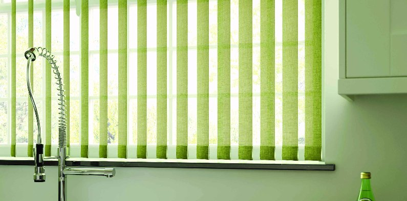 Bright green, vertical blinds in a kitchen
