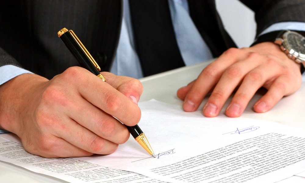 Professional signing the documents at trusted title company in Gallup, NM