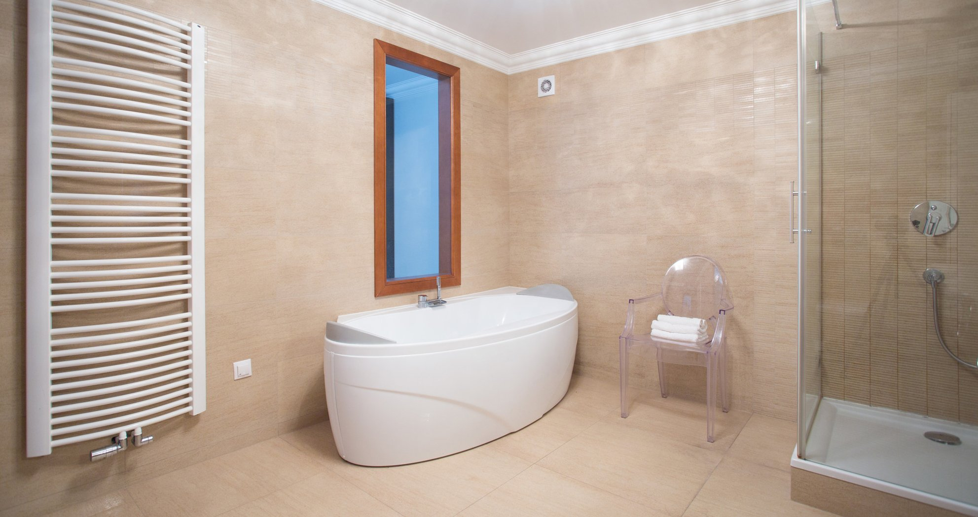 wet room with free standing bath and transparent chair