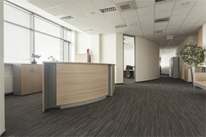 A white suspended ceiling in an office.