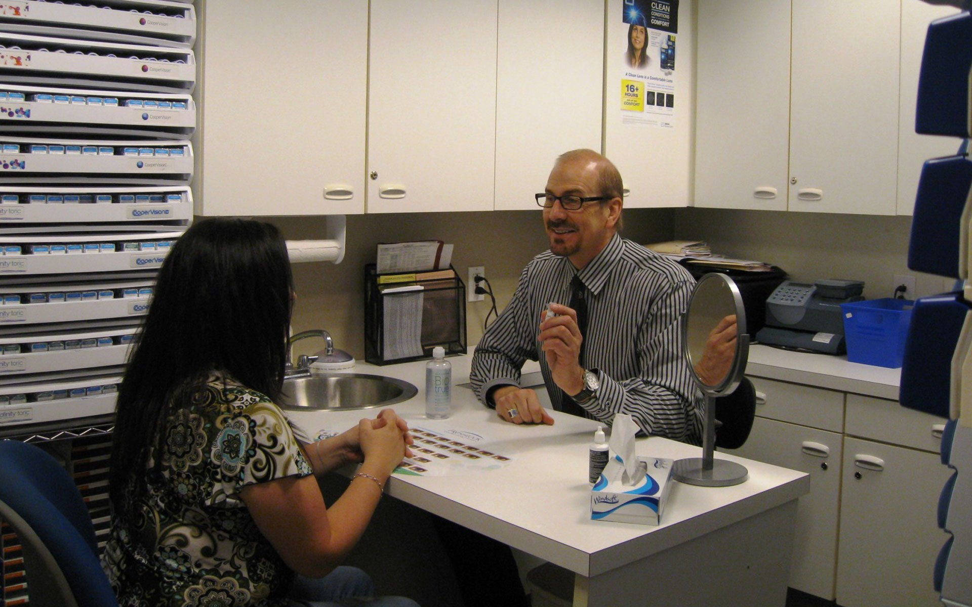 Eye doctor in Greensboro, NC consulting patient