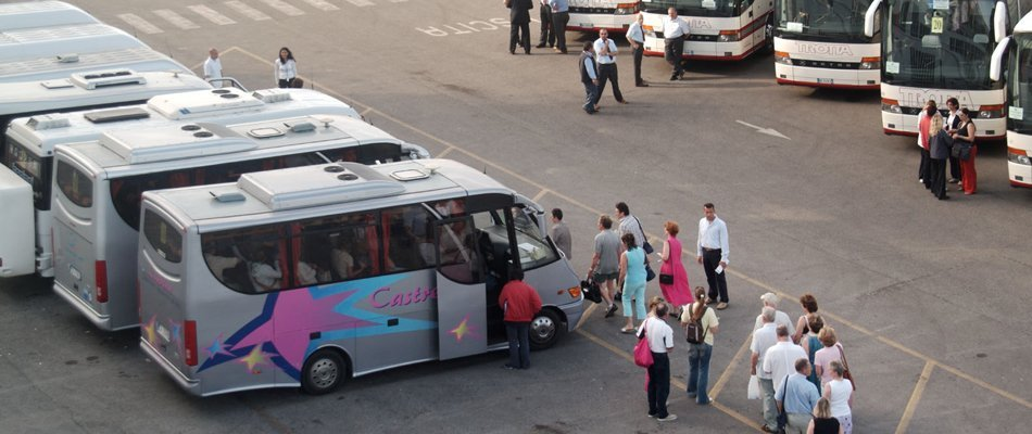 Crowd of holidaymakers entering minibus