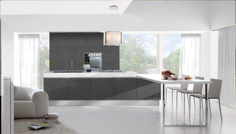 la cucina moderna con mobili neri e un tavolo con 3 sedie