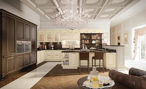 una cucina con mobili color legno scuro e avorio