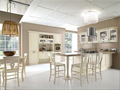 una cucina moderna con mobili color avorio