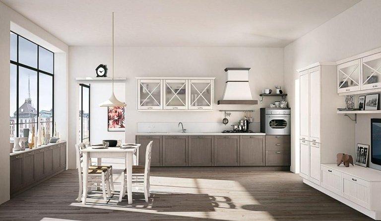 una cucina in legno e di color bianco e un tavolo con delle sedie