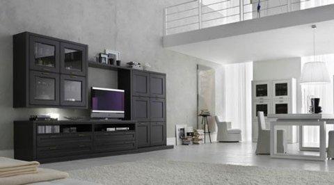 mobile nero con una TV e un tavolo bianco
