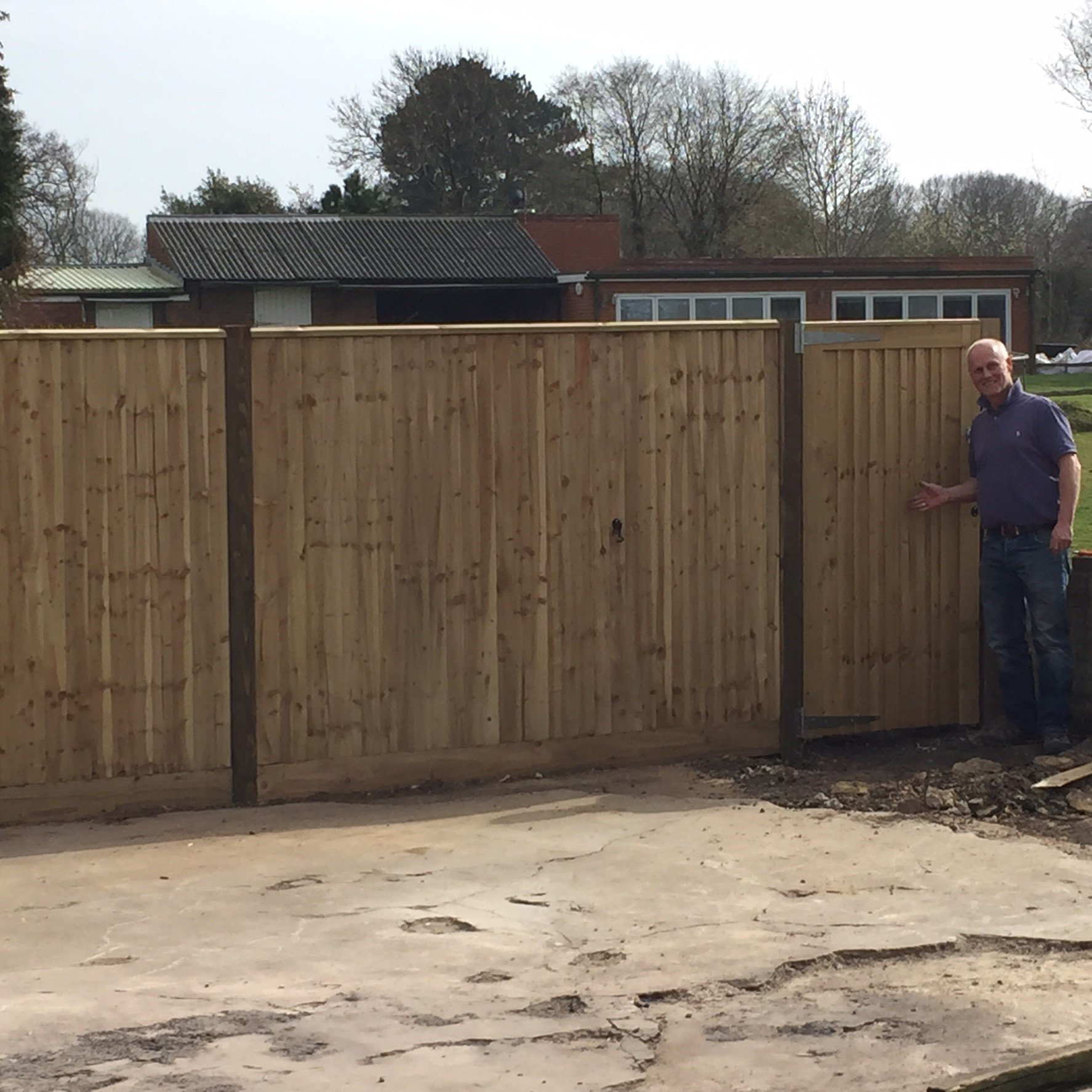 Completed wooden fence installation