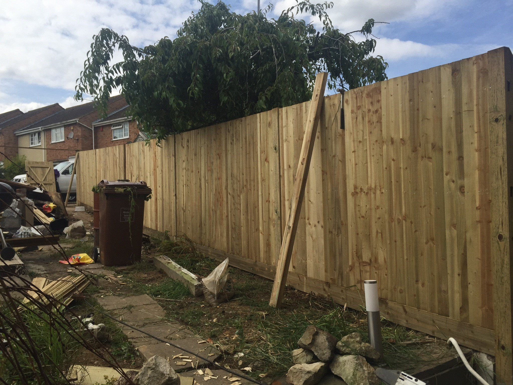 Wooden fence being installed