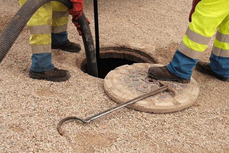Sewer workers in action