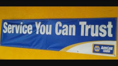Service you can trust banner at Dean's Automotive Service Center in Anchorag