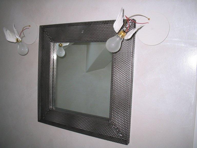 specchio profilato in ferro