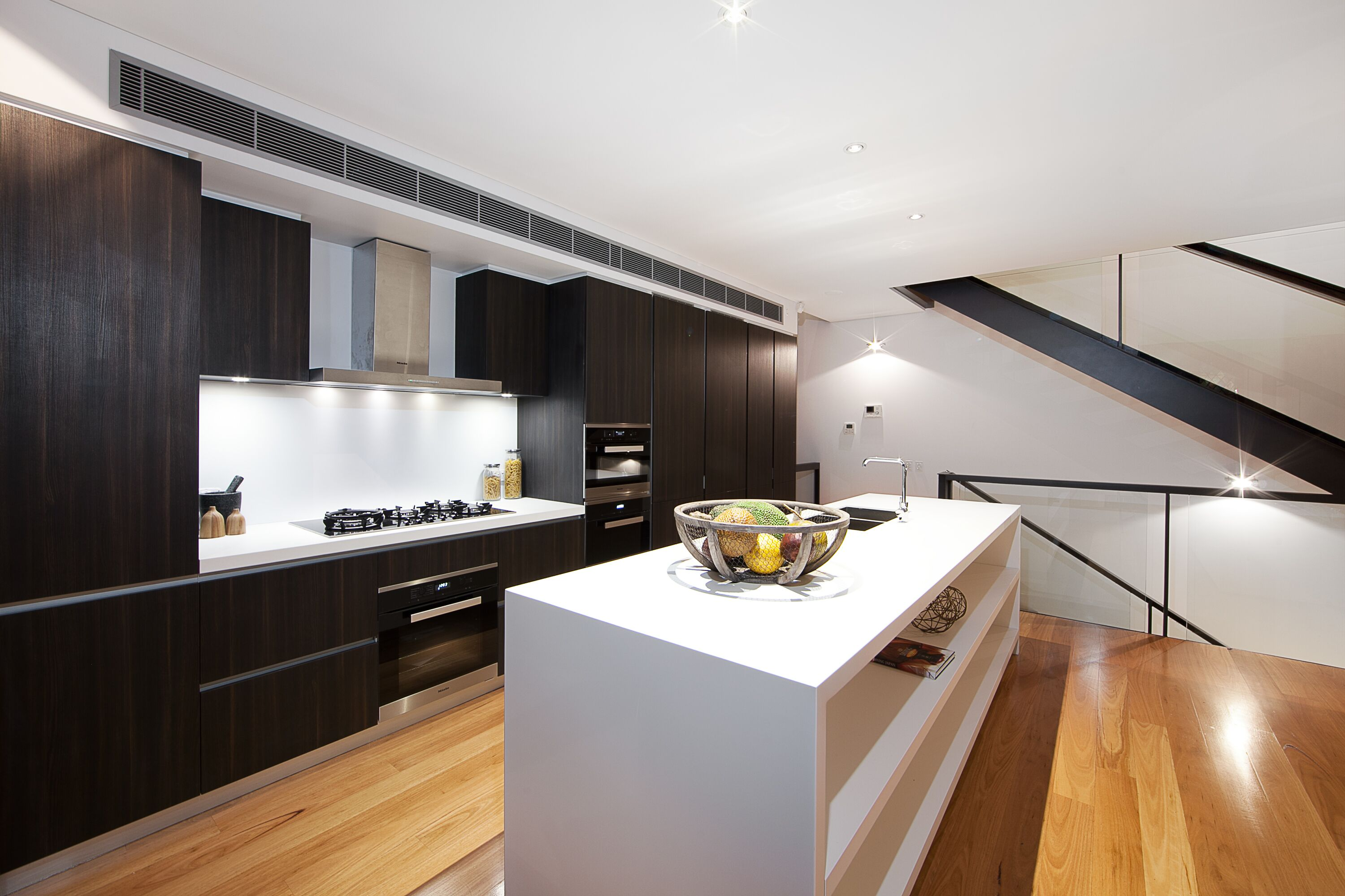 Kitchen area of new Sydney apartments with lighting and electrical work
