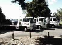 ardies towing tow truck line up with vehicle