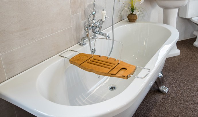 Wooden tray over bath