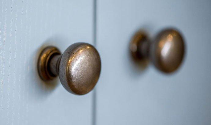 Doorknobs on bathroom cabinets