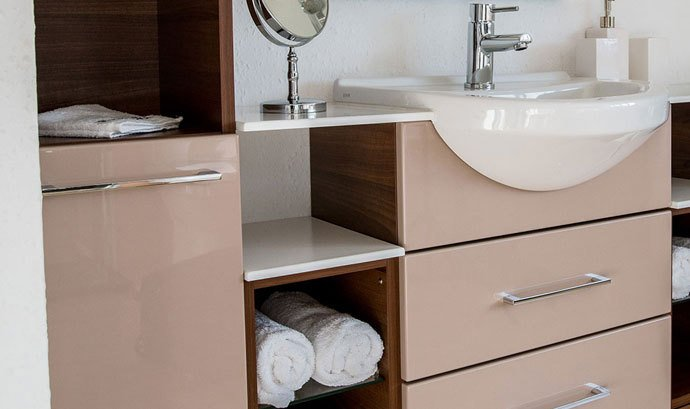 A vanity unit with drawers and shelves