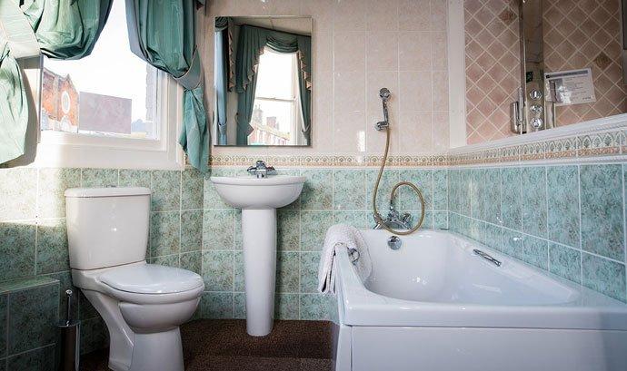 Bathroom suite of bath, sink and toilet