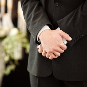 man at funeral
