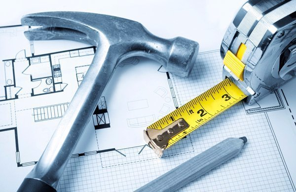 hammer, tape measure and home plans