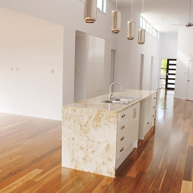 granite island bench and timber floors