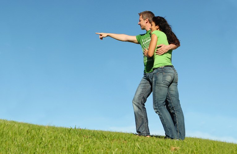 young couple looking at land for jac home
