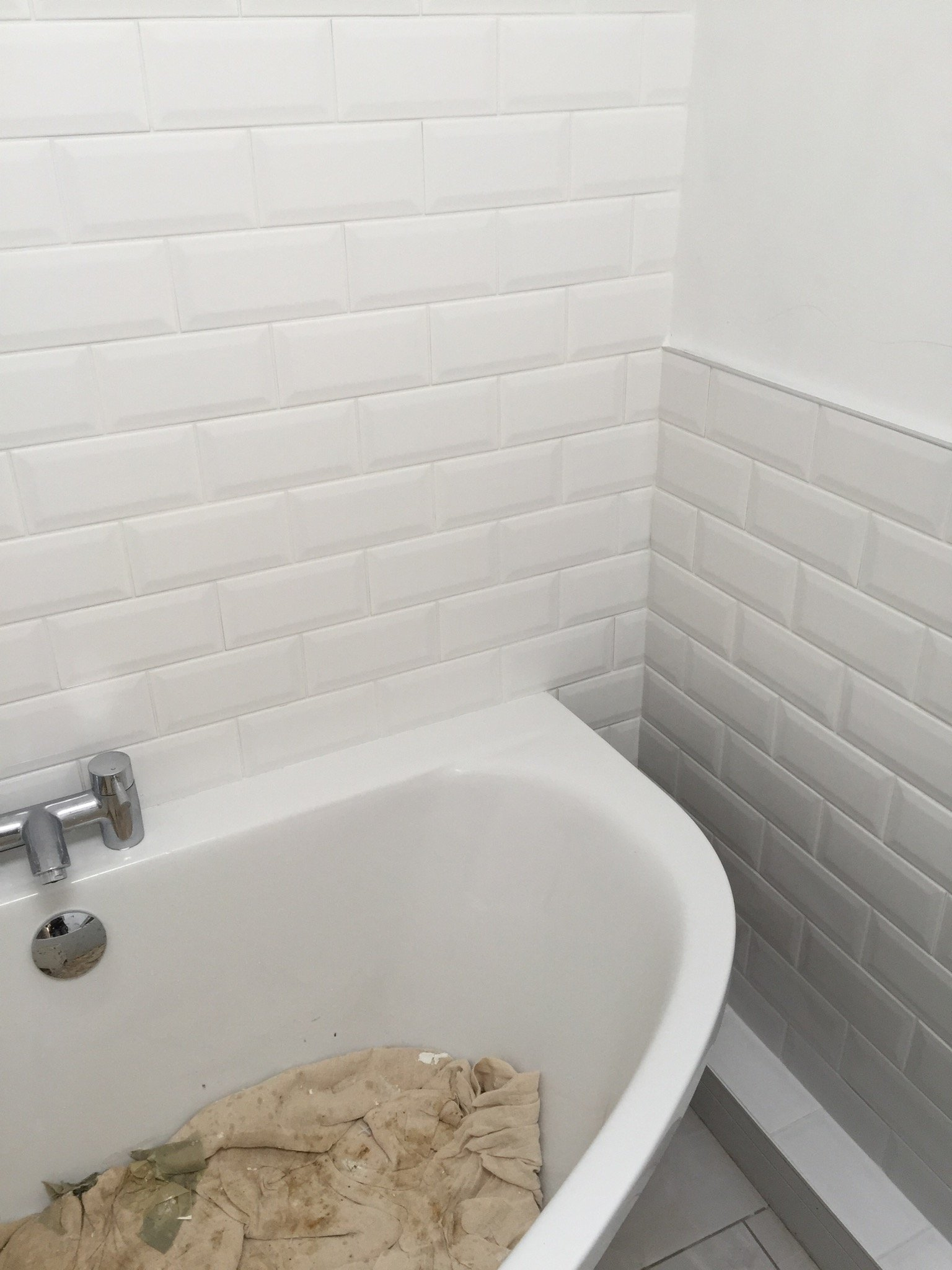 tilled bathroom and white sink