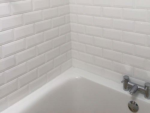 tilled bathroom andd white bathtub