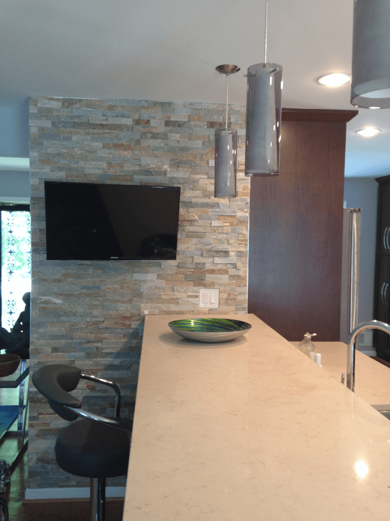 Kitchen seating bar with drop down lights.