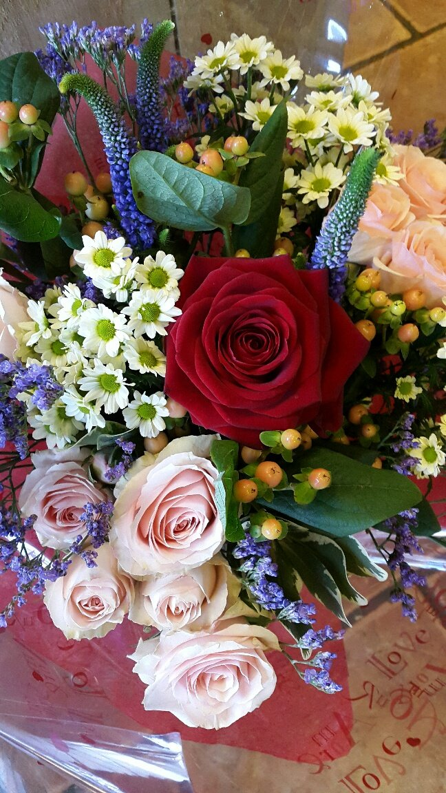 different types of flowers in a bouquet