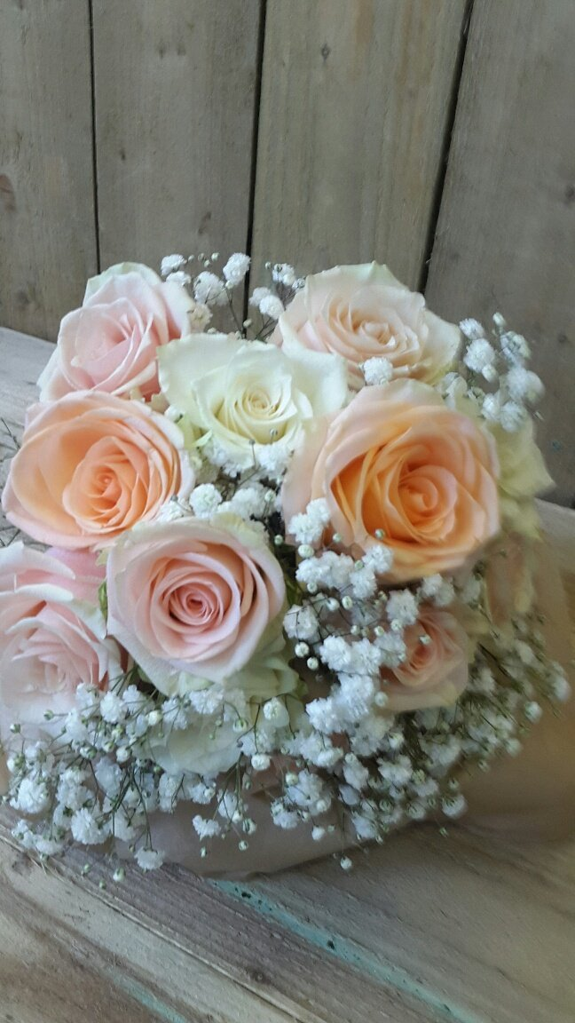 orange coloured hand bouquet