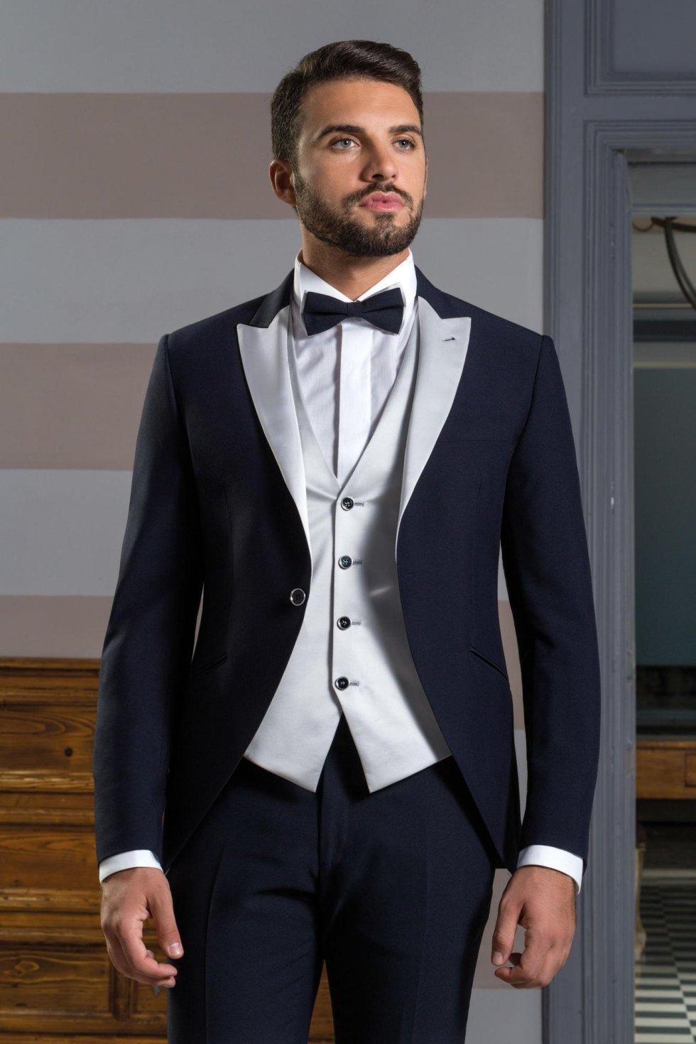 Smoking da sposo blu giacca stondata con revers e gilet grigio argento