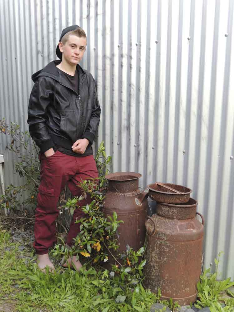 Young individual standing next to the temporary wall