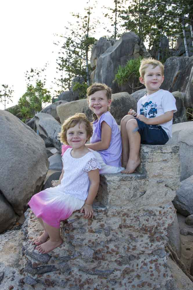 Kids enjoying while sitting on big stones