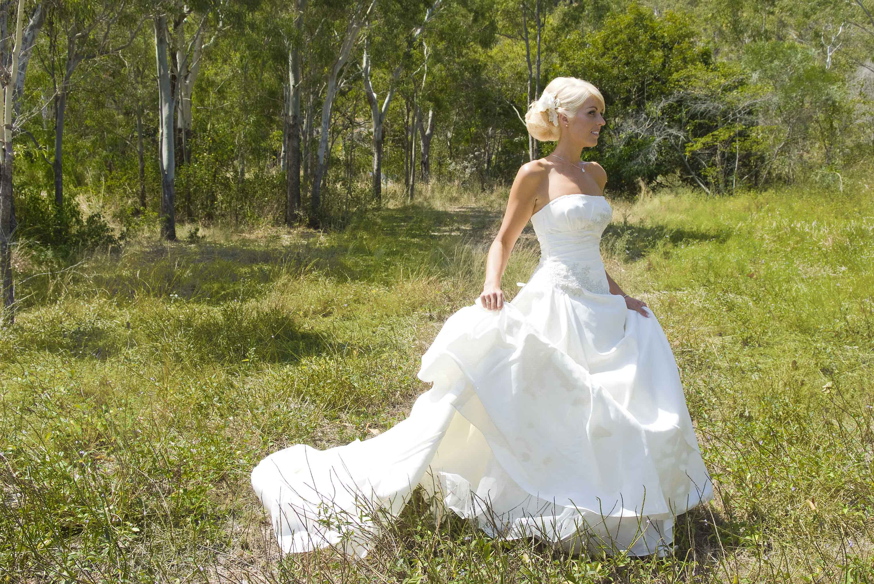 Bride strolling in the park