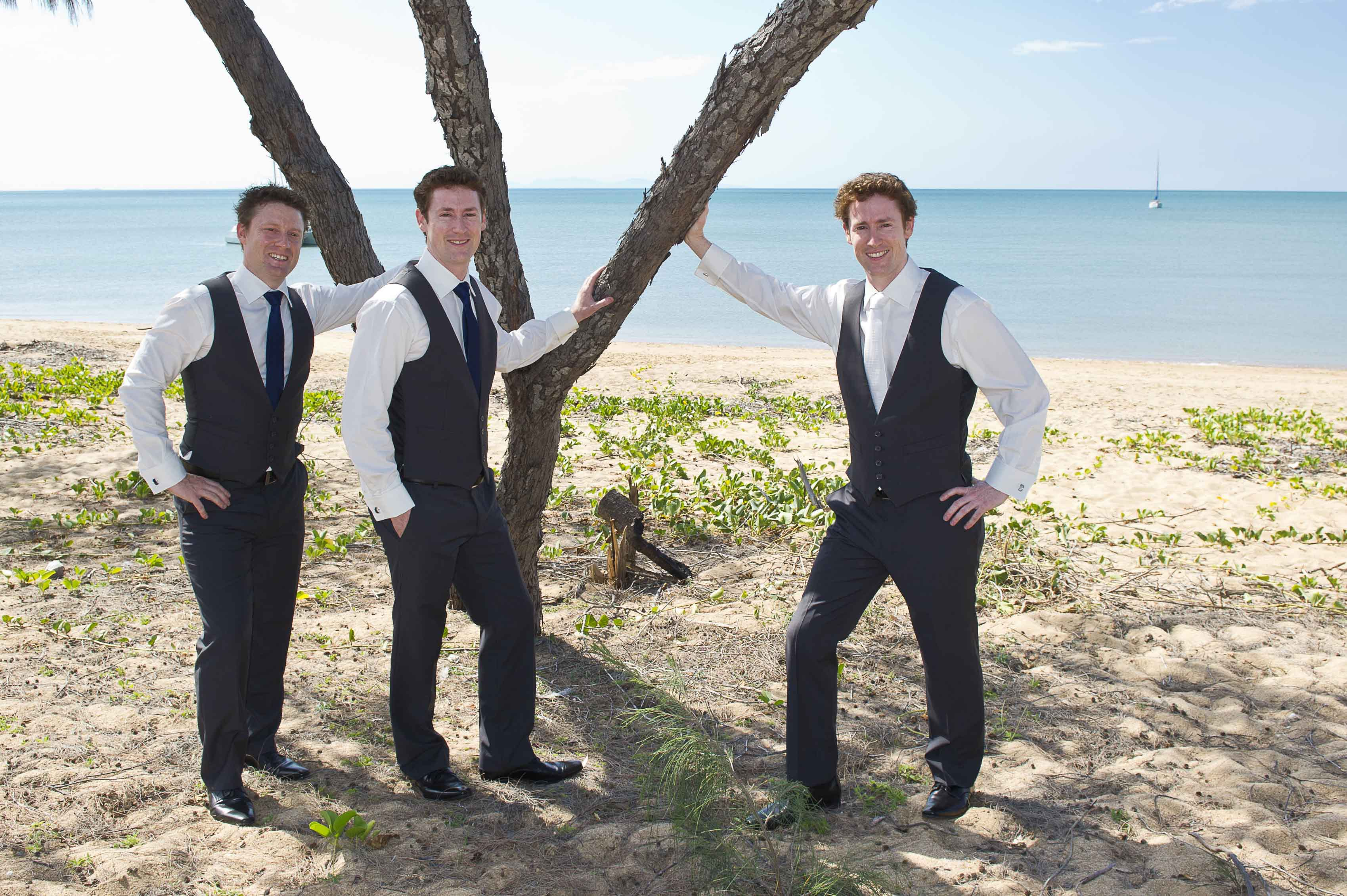 Groom with his friends by the calm water