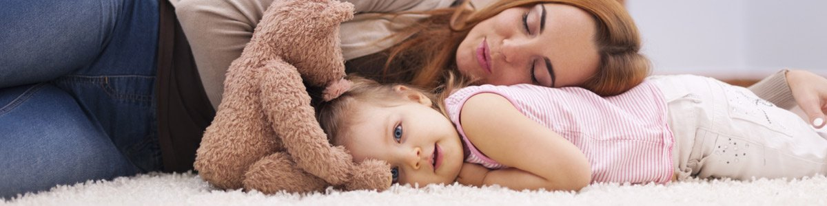 royce cleaning and property maintenance services pty ltd woman and kid lying in carpet
