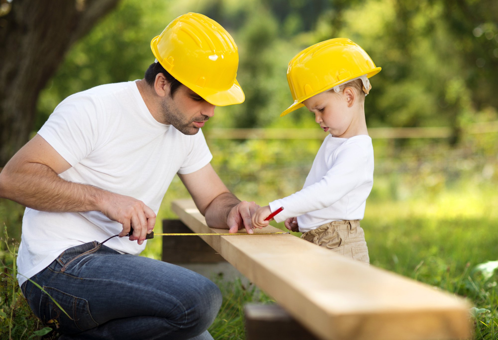 father and son doing carpentry
