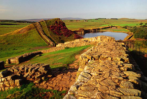 Panaromic view of Hadrian's Wall with grass fields