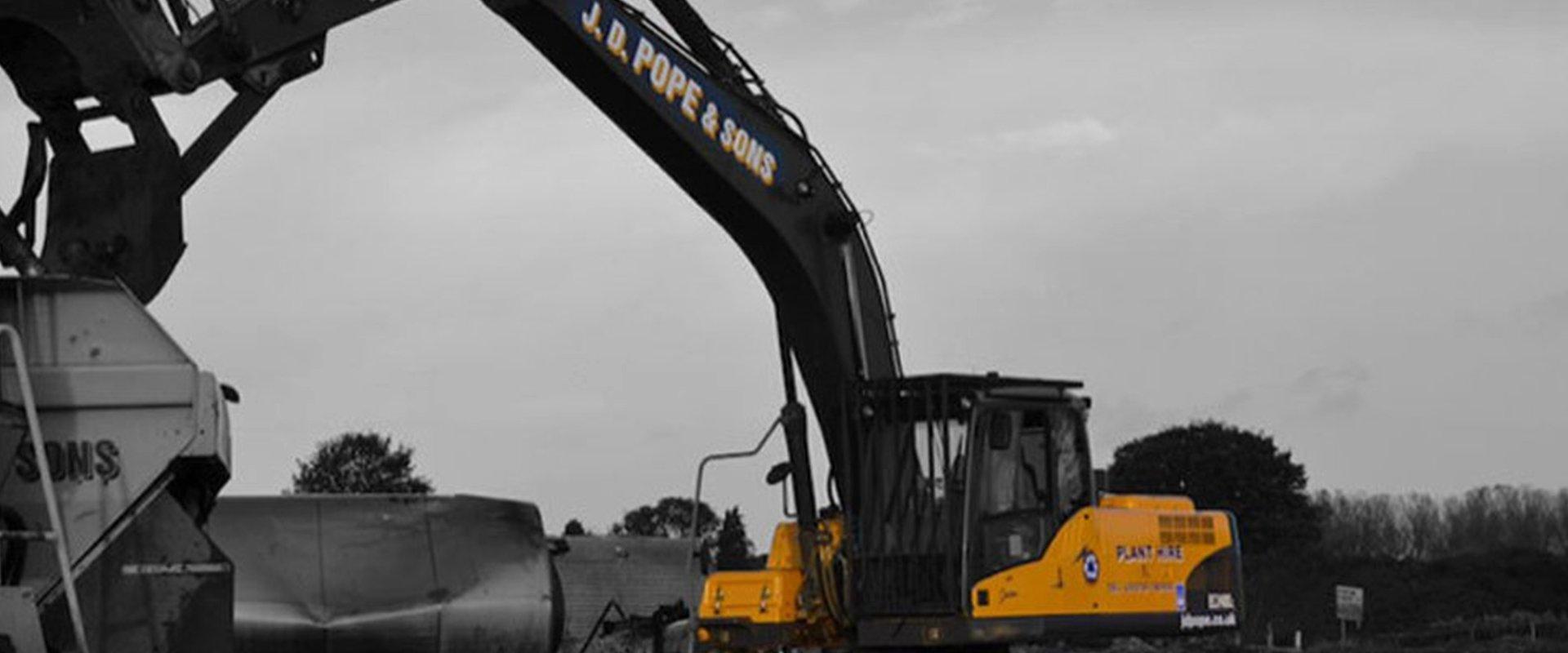 yellow coloured Excavator