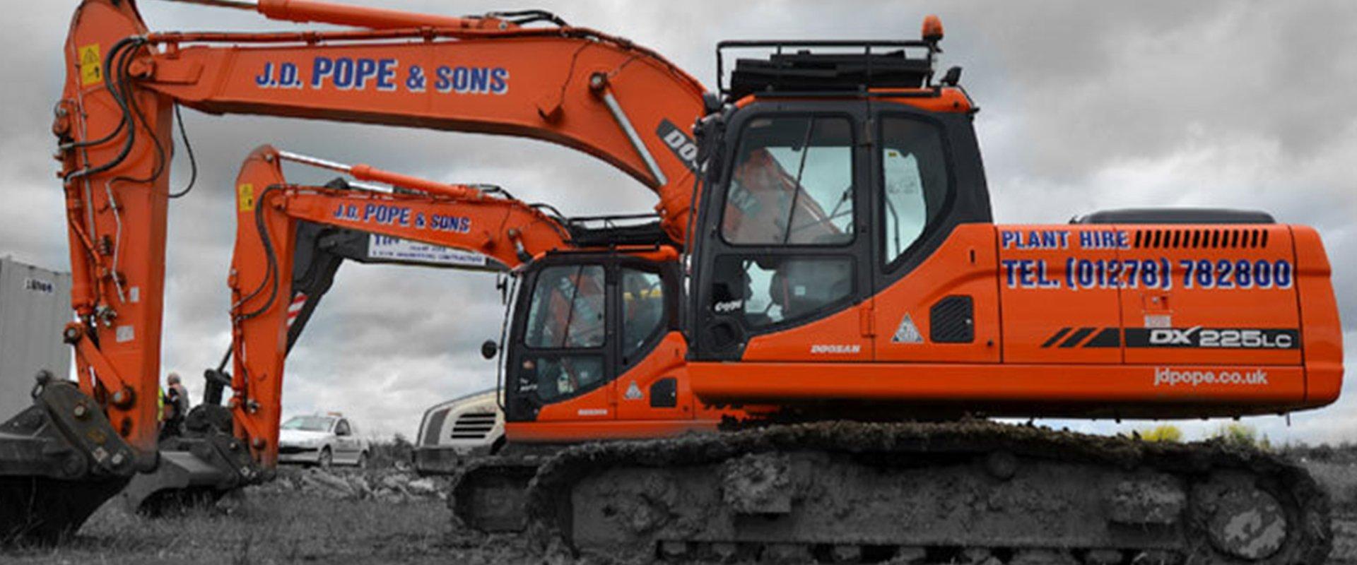 orange coloured Excavator