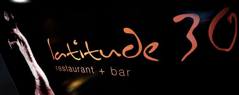 latitude 30 restaurant and bar sign