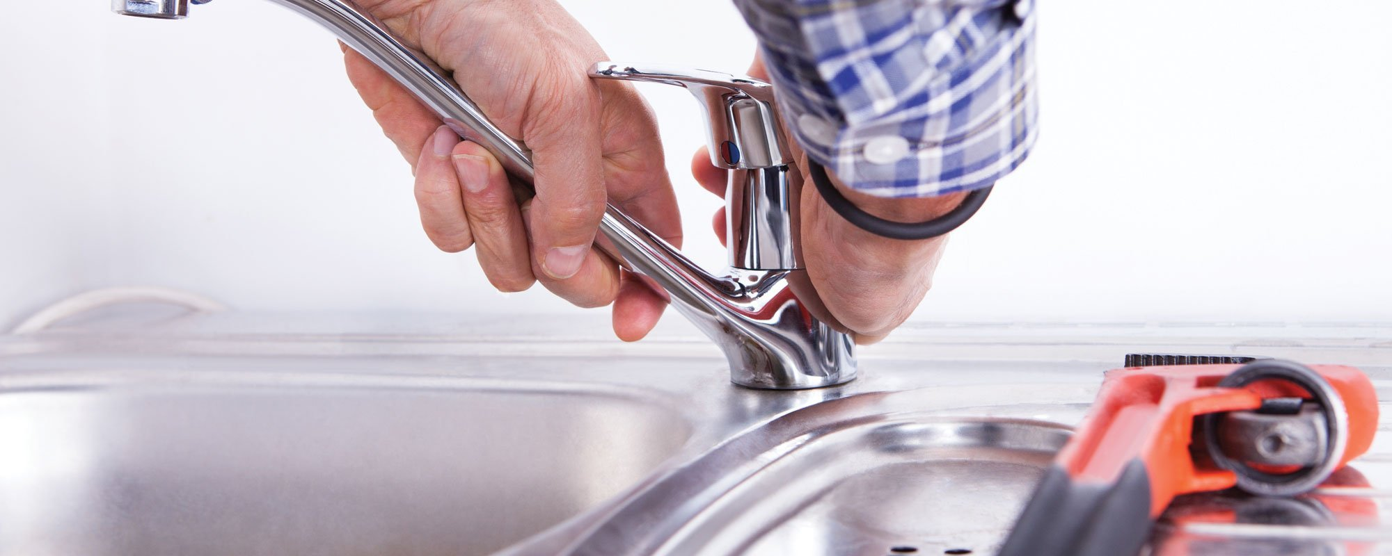 Faucets being installed by expert