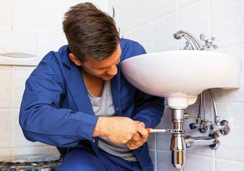 Plumber doing the bathroom repair work